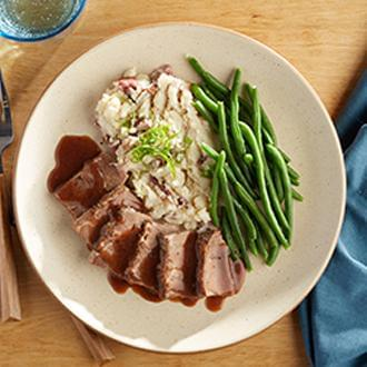 Homestyle Brisket with Smashed Red Skin Potatoes with Butter with Green Beans