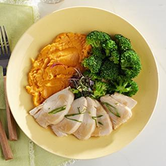 Sliced Roast Turkey Breast with Natural Gravy with Herb Roasted Red Potatoes with Broccoli