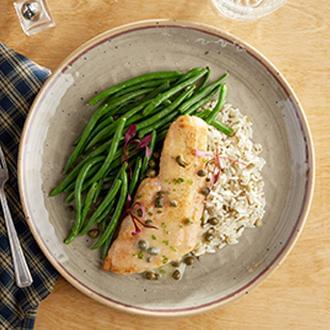 PREMIUM LINE:  Seared Haddock with Butter Wine Caper Sauce with Vegetable CousCous with Peas