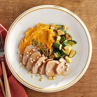 Sliced Roast Loin of Pork with Warm Apple Gravy with Sweet Potatoes with Zucchini